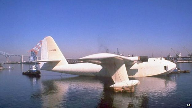 Howard Hughes wooden flying boat, known as the Spruce Goose, is towed from its hangar at Long Beach, California, on 29 Oct 1980, where it had been stored