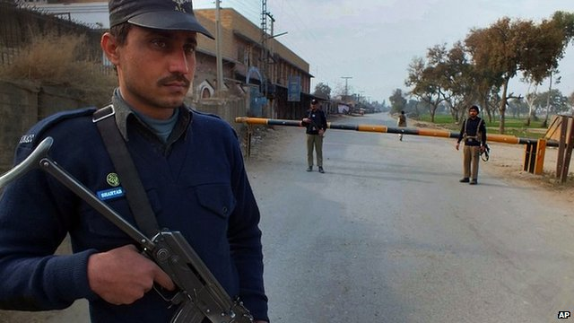 Pakistan police guard scene of militant attack. 19 Jan 2014
