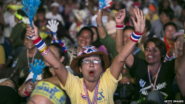 Anti-government protestors cheer as leader Suthep Thaugsuban speaks about the elections during his daily speech 3 February 2014 in Bangkok,Thailand