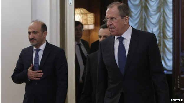 Russia's Foreign Minister Sergei Lavrov (R) and Syrian opposition leader Ahmad Jarba (L) arrive for a meeting in Moscow on 4 February 2014