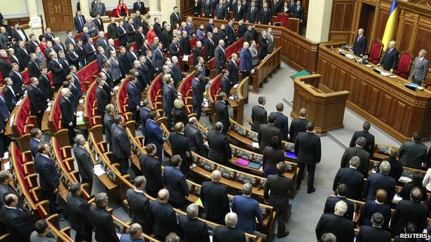 Deputies and acting government members (top) attend the opening ceremony for a new parliament session in Kiev