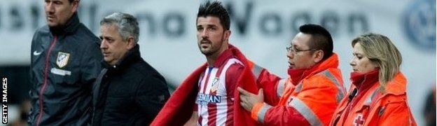David Villa (centre) comes off injured v Real Sociedad