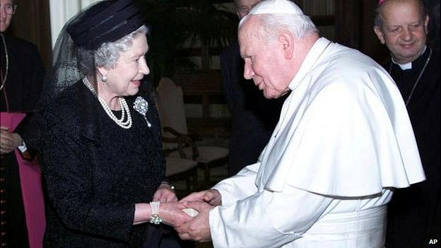 The Queen and Pope John Paul II shake hands