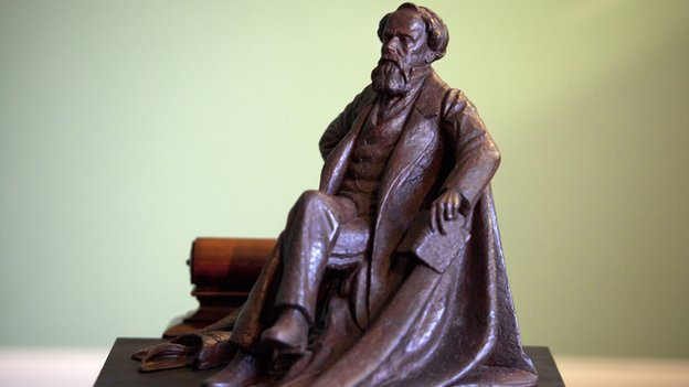 A bronze maquette showing what the Charles Dickens statue will look like