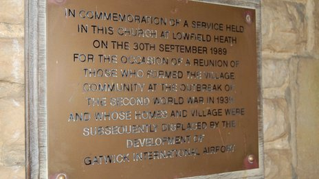 Plaque commemorating service held for the reunion of people who used to live in the village
