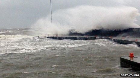 Huge waves crash against the harbour in Kilkeel, County Down