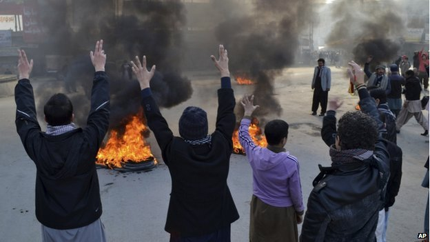Pakistani Muslim Shiites chant slogans and burn tires, during a protest in Quetta, Pakistan, Wednesday, Jan. 22, 2014.