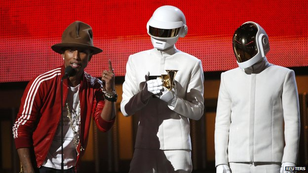 "Pharrell Williams accepts the award for record of the year for Daft Punk for ""Get Lucky"" at the 56th annual Grammy Awards in Los Angeles"