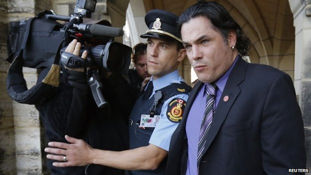 Senator Patrick Brazeau leaves Parliament Hill in Ottawa, Ontario in 23 October 2013