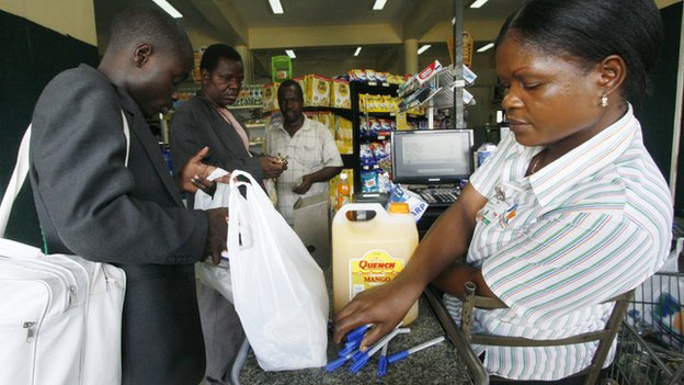 A cashier at  Food World, a supermarket in Zimbabwe's capital