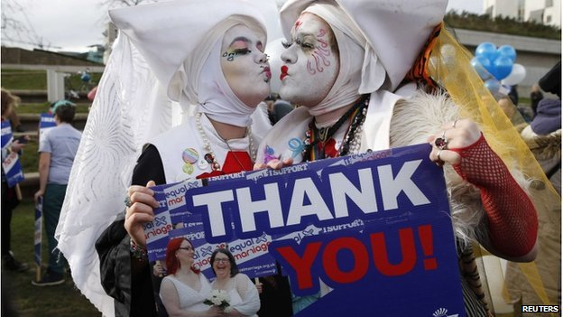 Supporters attend a symbolic same-sex marriage outside the Scottish Parliament