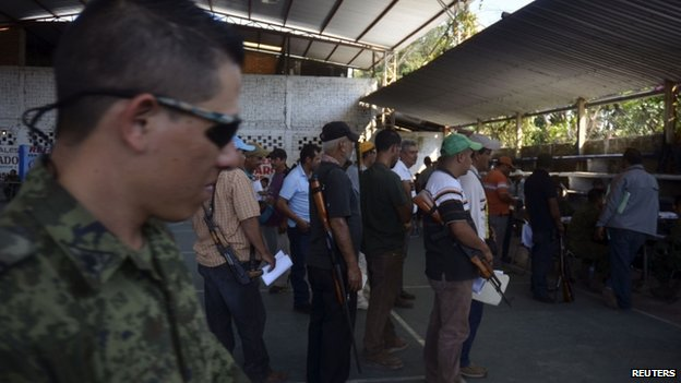 Vigilantes queue up to register their weapons and join a Rural Defence Corps