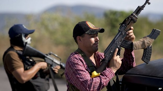 Local militia at a checkpoint at the entrance of Antunez, Mexico. 28 Jan 2013