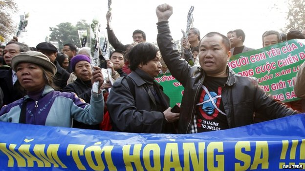 Protesters during a gathering to mark the 40th anniversary of the Chinese occupation of the disputed Paracel islands in the South China Sea, in Hanoi, Vietnam, 19 January 2014