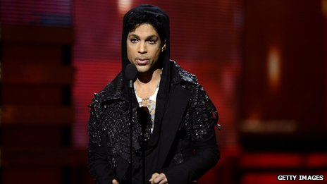 Prince on stage at the Grammys