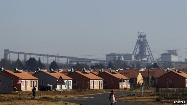 A women walks in a Soweto township overlooking the Doornkop Gold Mine, about 30km (19 miles) west of Johannesburg