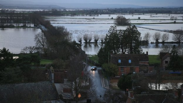 Flooded fields can be seen beside the A361