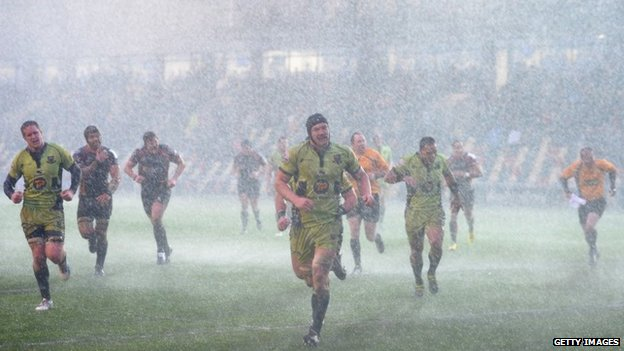 Newport Gwent Dragons and Northampton Saints abandon the pitch during their rugby match on 25 January, 2014 in Newport, Wales