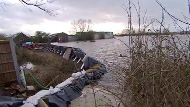Barrier holding back flood water in Moorland
