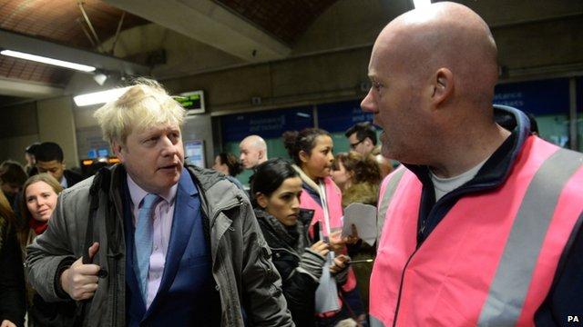 London Mayor Boris Johnson with staff at London Bridge
