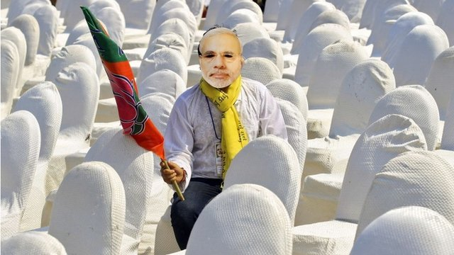 A volunteer of Indias main opposition Bharatiya Janata Party (BJP), wearing a mask of Hindu nationalist Narendra Modi