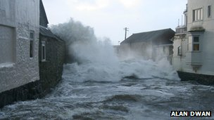 Waves hitting properties in Newlyn, Cornwall