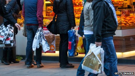 Shoppers pass a bakery in Hamburg