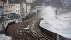 Waves break over the railway line at Dawlish, Devon