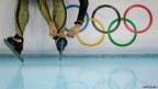Japanese speedskater Shiho Ishizawa ties the laces of her skates