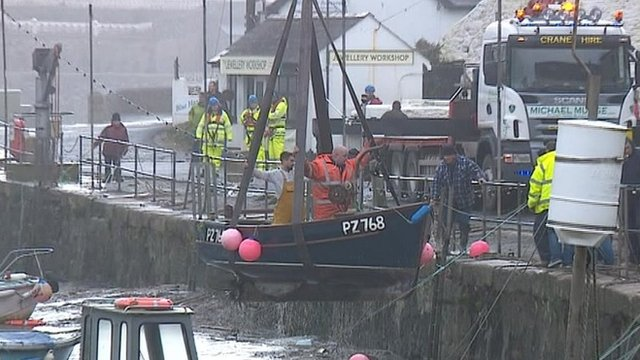 Boats winched from Porthleven Harbour