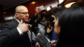 Peter Pannu speaks to reporters following the EGM at the Shangri-La Hotel in Hong Kong (5 February 2014)