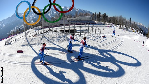 Officials ski the Olympic course in Sochi