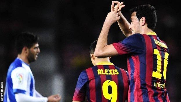 Sergio Busquets celebrates his goal