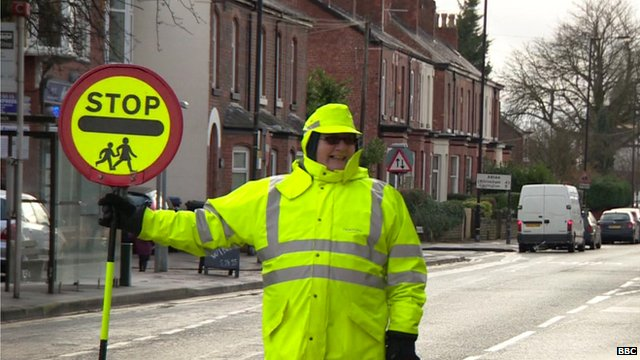 Smiling lollipop lady in Wythenshawe