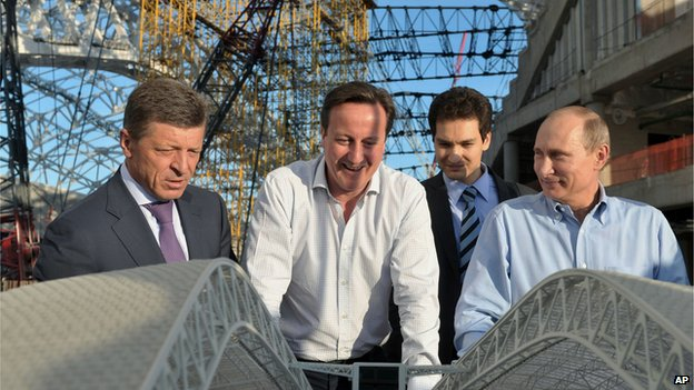 Russian President Vladimir Putin, right, and British Prime Minister David Cameron visit the Fisht Olympic Stadium on 10 May 2013.