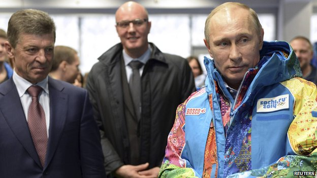 Russia's President Vladimir Putin (R), Organising Committee Head Dmitry Chernyshenko (C) and Deputy Prime Minister Dmitry Kozak (L) visit an Olympic volunteers centre in Sochi on 4 January 2014.