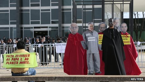 A protesters demonstrate in front of the Federal Supreme Court of Brazil on 18 September, 2013