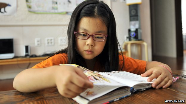 A South Korean girl reads a book