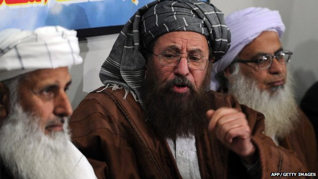 Members of a committee from Tehreek-e-Taliban Pakistan (TTP) which was set up to hold talks with the government of Pakistan, chief cleric of Islamabad's Red Mosque, Maulana Abdul Aziz (R) and two senior religious party leaders, Maulana Sami-ul-Haq (C) and Professor Ibrahim Khan (L) speak with media representatives in Islamabad on February 4, 2014.