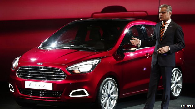 Kumar Galhotra, vice-president, engineering, Ford Motors, stands next to a Ford Figo concept car at the India motor show 2014