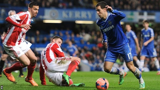 Chelsea's Eden Hazard (right) looks to go around Stoke City's Marko Arnautovic (floor) and Geoff Cameron