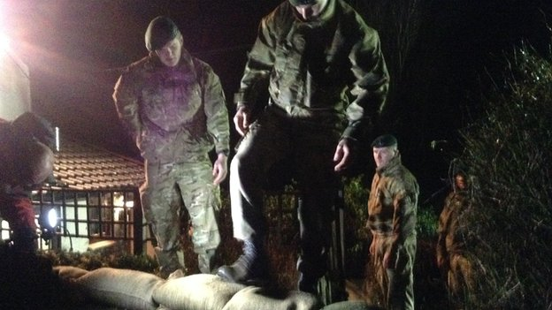 Royal Marines reinforce defences with sandbags in the Somerset Levels