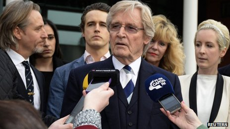 William Roache, surrounded by his family, speaks to the media outside court