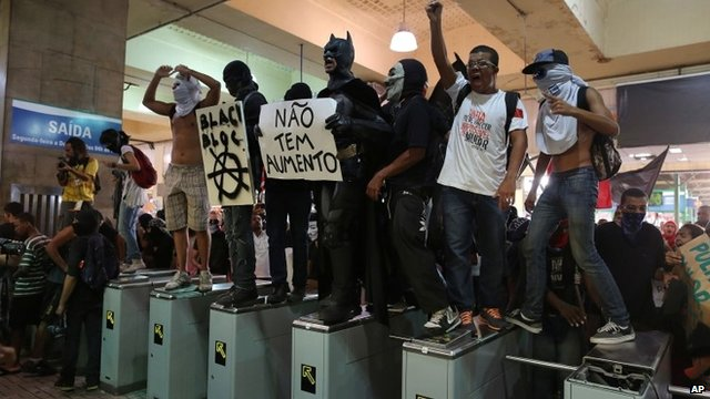 Protesters standing on tickets barriers
