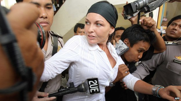 Schapelle Corby is escorted by police to a court room in Bali island on 25 August 2006