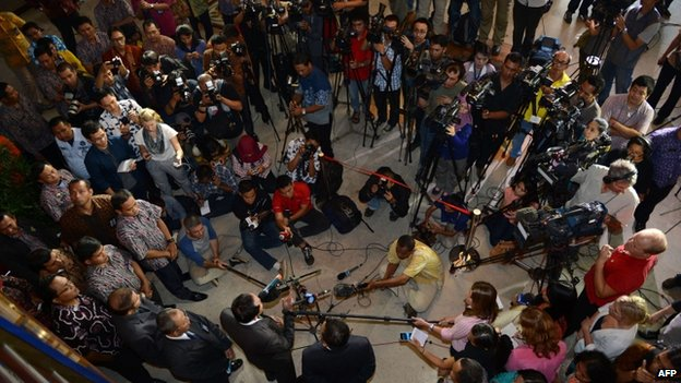 Indonesian Justice Minister Amir Syamsuddin (bottom) arrives for a press conference in Jakarta announcing Indonesia has granted parole to Australian drug trafficker Schapelle Corby, 7 February 2014