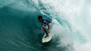 Surfer off the Philippines coast