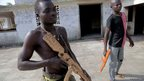 Army recruits with wooden weapons at Bokassa's old palace - Central African Republic, February 2014