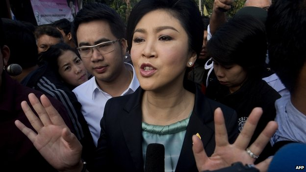 Thai Prime Minister Yingluck Shinawatra answers questions from the press after voting at a polling station in Bangkok on 2 February 2014