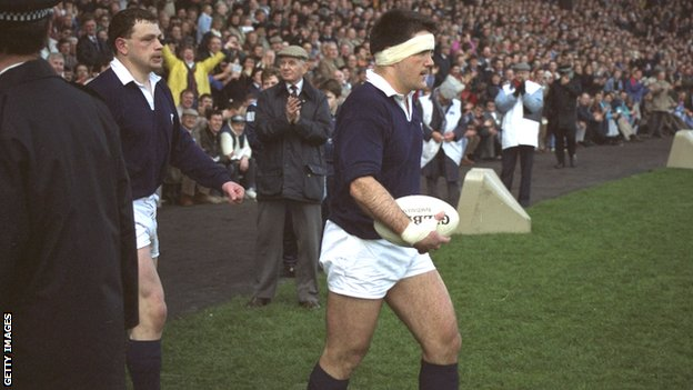 David Sole leads Scotland out onto the pitch in 1990